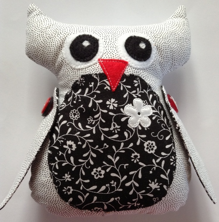 A delightful black, white and red owl softie with button detail on the wings. This cutie pie will stimulate your newborn's vision and hold their attention.