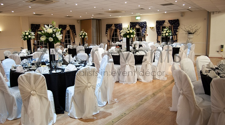 White wraps with diamante buckles on white chair covers.  Manor of Groves, Sawbridgeworth