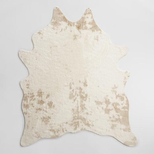 Our animal-friendly faux cowhide rug captures the chic, authentic look and  remarkable texture of natural cowhide. This easy-care,