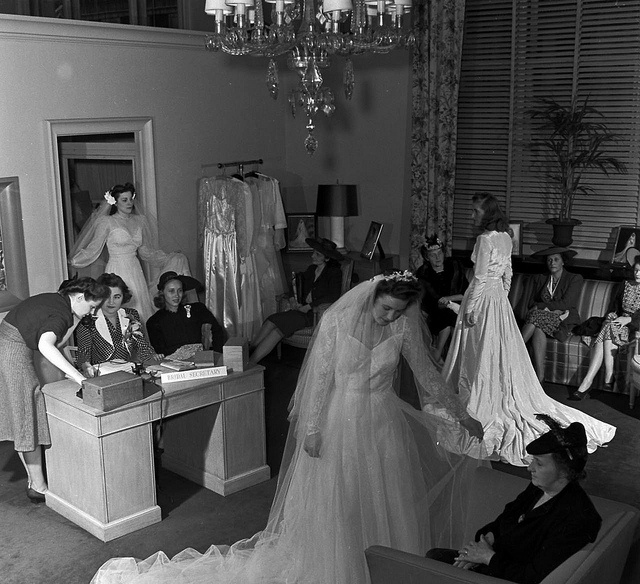 A group of vintage brides-to-be shopping for their beautiful wedding gowns, ca. 1940s.  Look, they aren't baring their shoulders! Such a breath of fresh air.