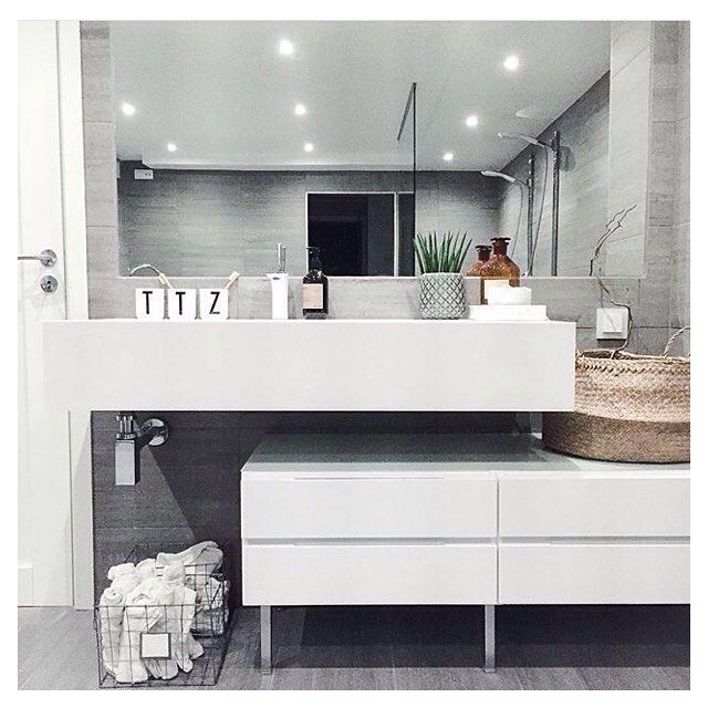 Simple, clean lines with white doors without handles.This is one cool bathroom at the home of @aboutaliving #kvikkitchen #kvik #bathroom #manobykvik www.kvik.nl Kvik Keukens Amsterdam