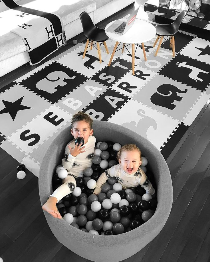 Stylish playroom flooring using SoftTIles Interlocking Foam Play Mats. Create your own customized playroom floor by choosing the size, color, and shapes. Personalize it by adding your child's name to create a playroom that your child will love! #playroom #playmat #playroomdecor #nurserydecor #blackandwhite #kidsroom