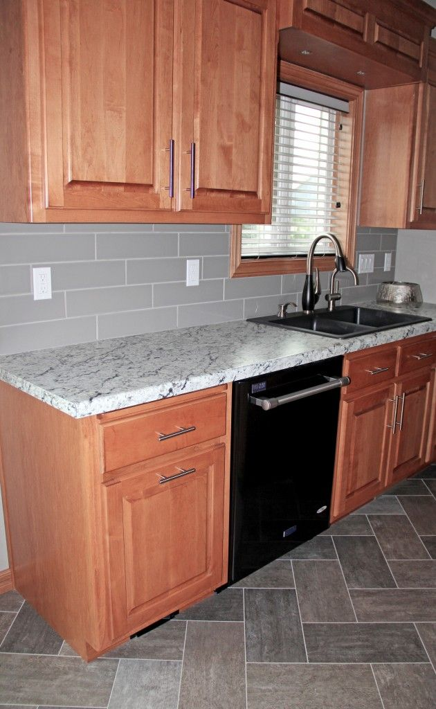 Maple Cabinets Gray Backsplash Tile Herringbone Tile Flooring