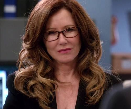 Mary McDonnell as Sharon Raydor. I wish I could get my hair to curl like that!