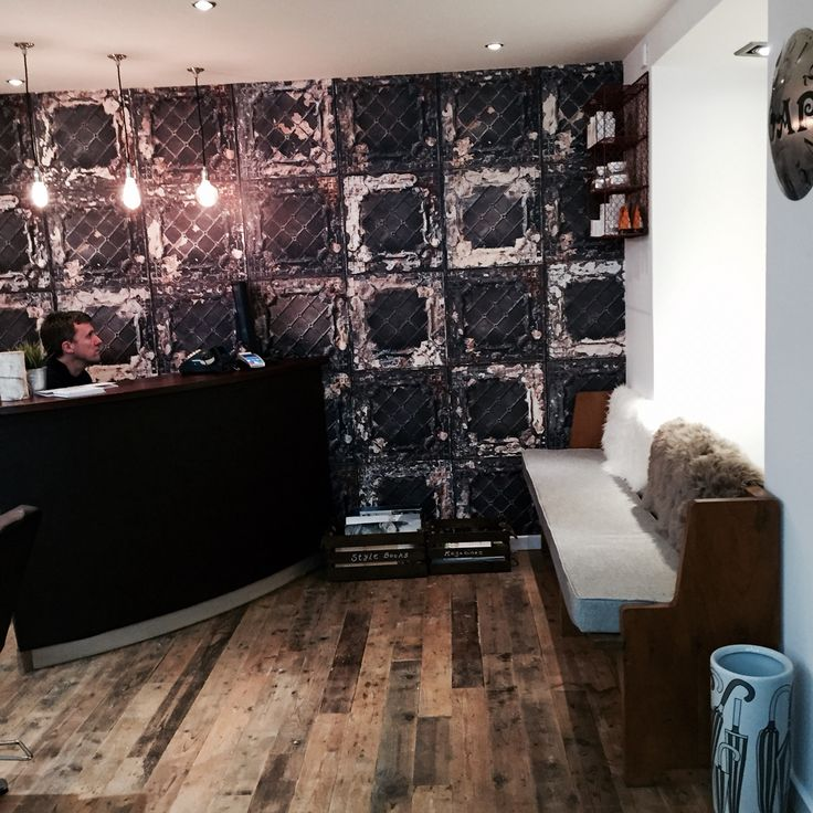 Salon interior design.  Brooklyn tin tiles wall paper  Reception desk Reclaimed wood Eco salon
