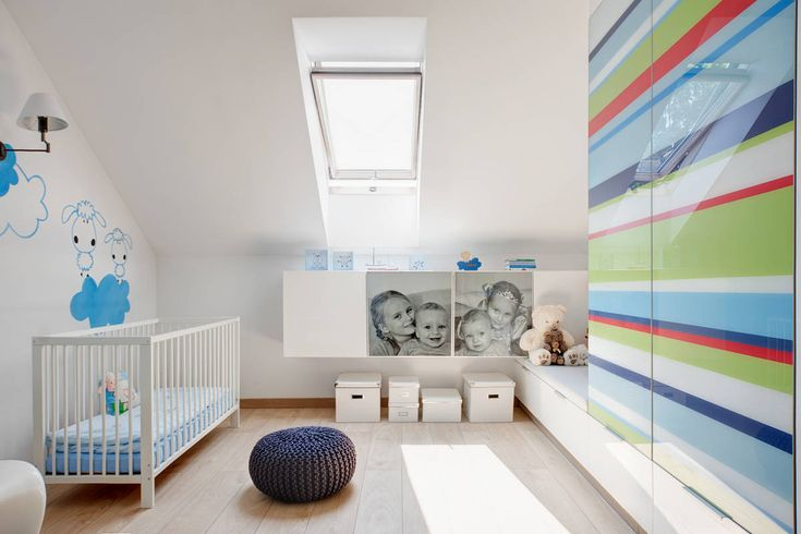 White Crib and Blue Wall Art under the Clear Skylight