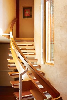 A timber and steel staircase leads to the bedrooms.