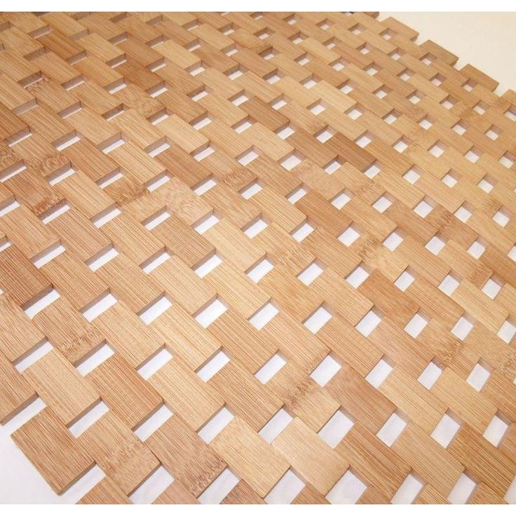 Una alfombra hecha con eslabones... de bambú. Para cuarto de baño.