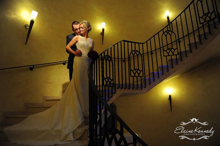 Couple pose in the stairs