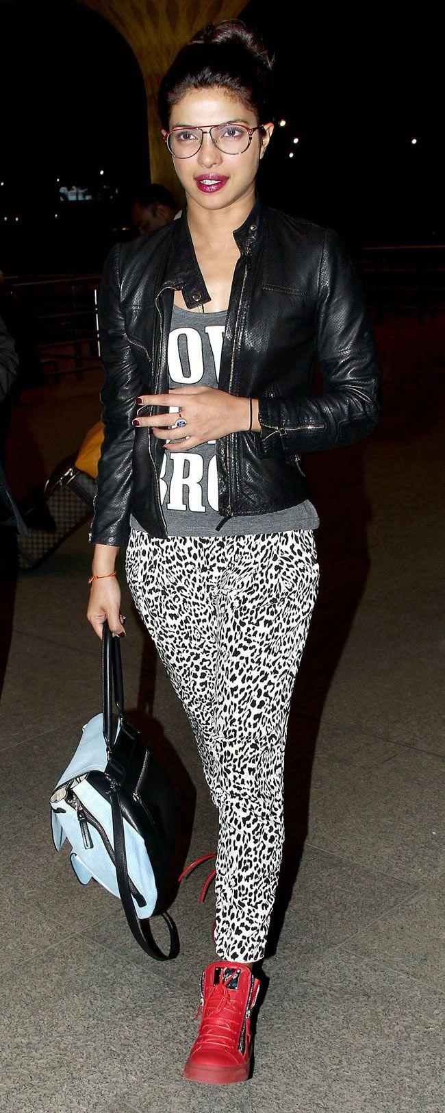 Priyanka Chopra spotted at the Mumbai airport in animal print tights, a tee shirt and black jacket