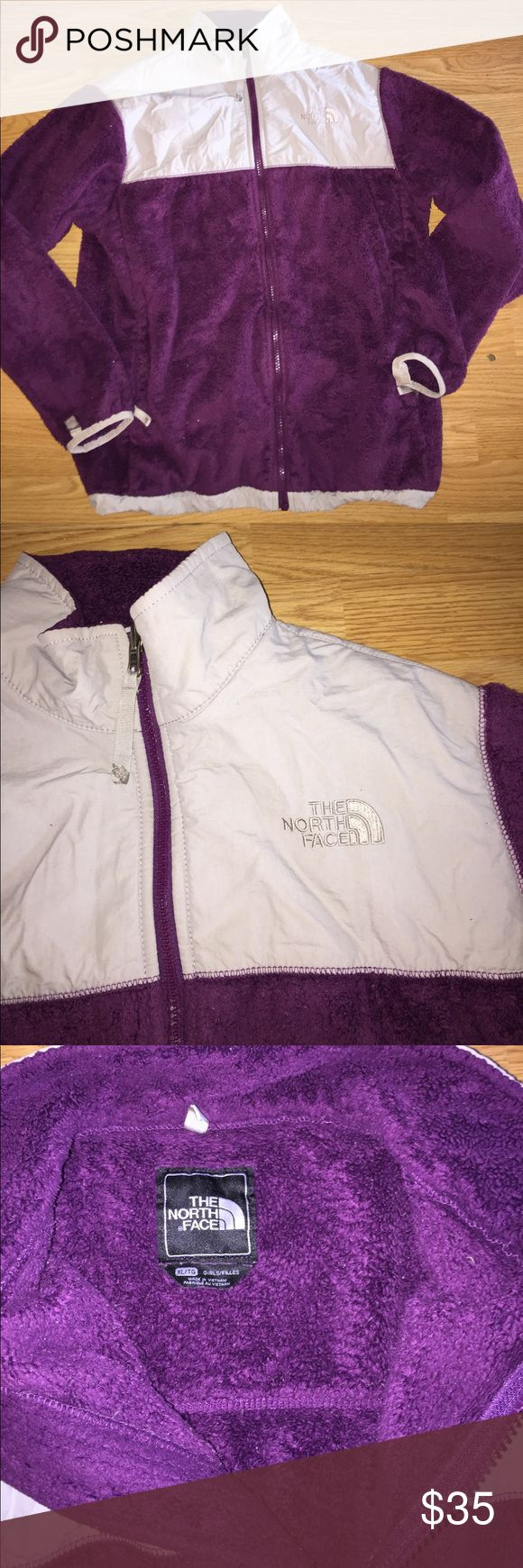 NORTHFACE jacket ladies small / kids XL purple NORTHFACE brand. Full zip up jacket. Tag says kids XL but I wore it and I'm a ladies small. Purple color with light gray accents. Zipper pockets in front. Jacket has hole on cuff of sleeve at lining edge (see pic). Could easily be sewn back together. This jacket shows wear so price reflects! This is still a good warm jacket though! Bundle with another item from my closet for a discount! North Face Jackets & Coats
