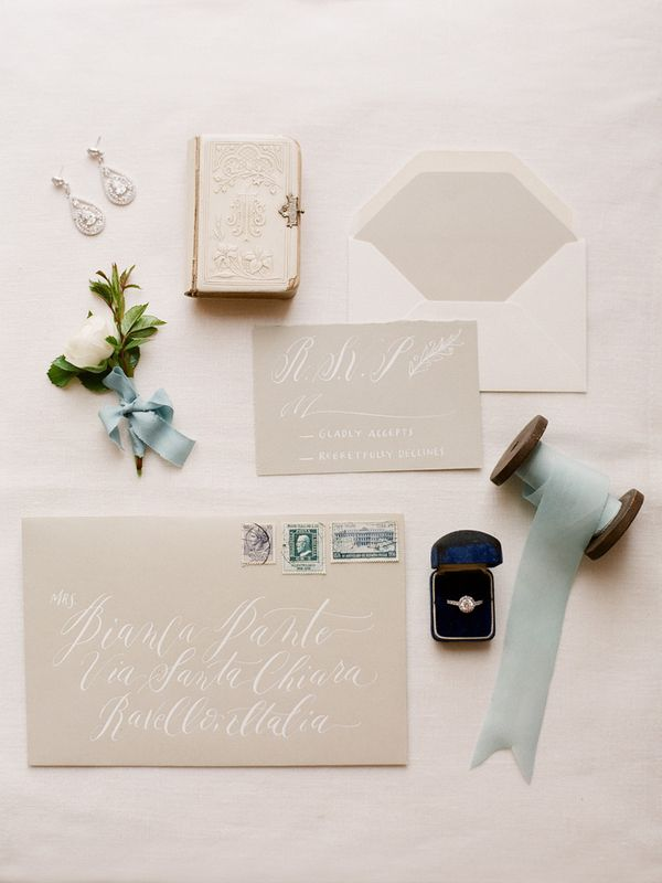 Elegant duck egg blue and calligraphy wedding stationery | See more on http://www.youmeantheworldtome.co.uk/wedding-theme-inspiration-timeless-elegance-italy/ Photography by Gert Huygaerts Photography