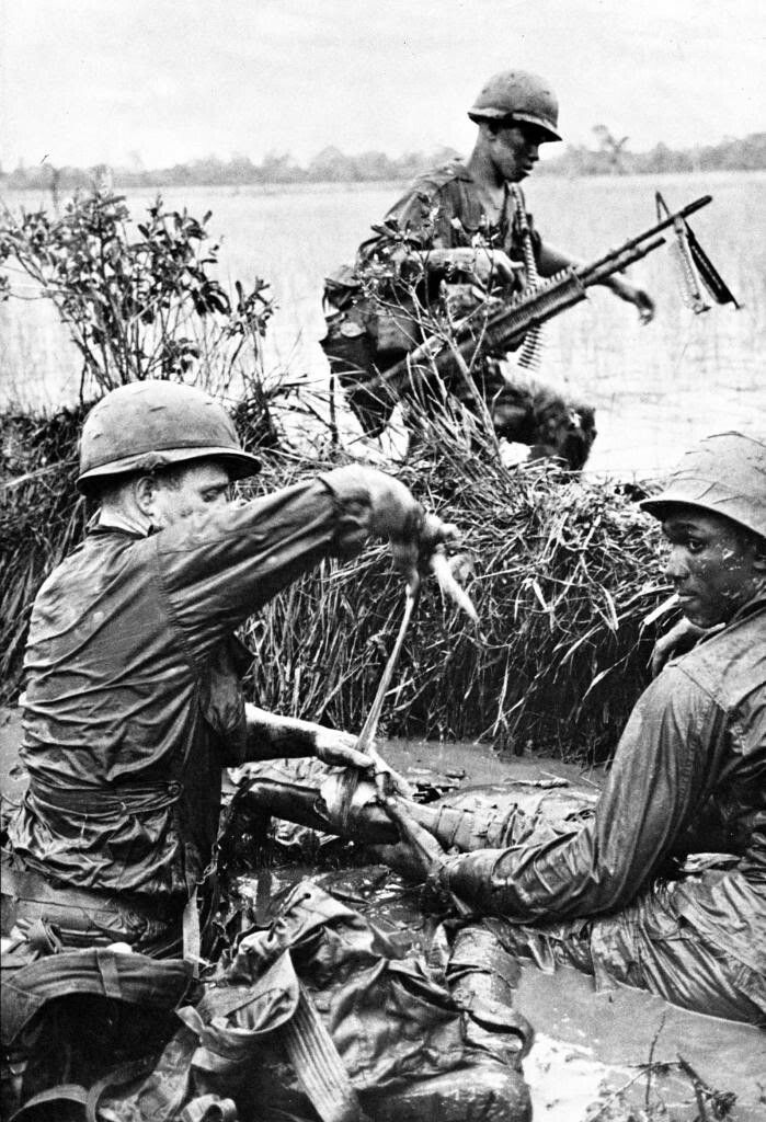 """""""1st Infantry Division Medic treating a wounded Grunt."""" ~ Vietnam War"""