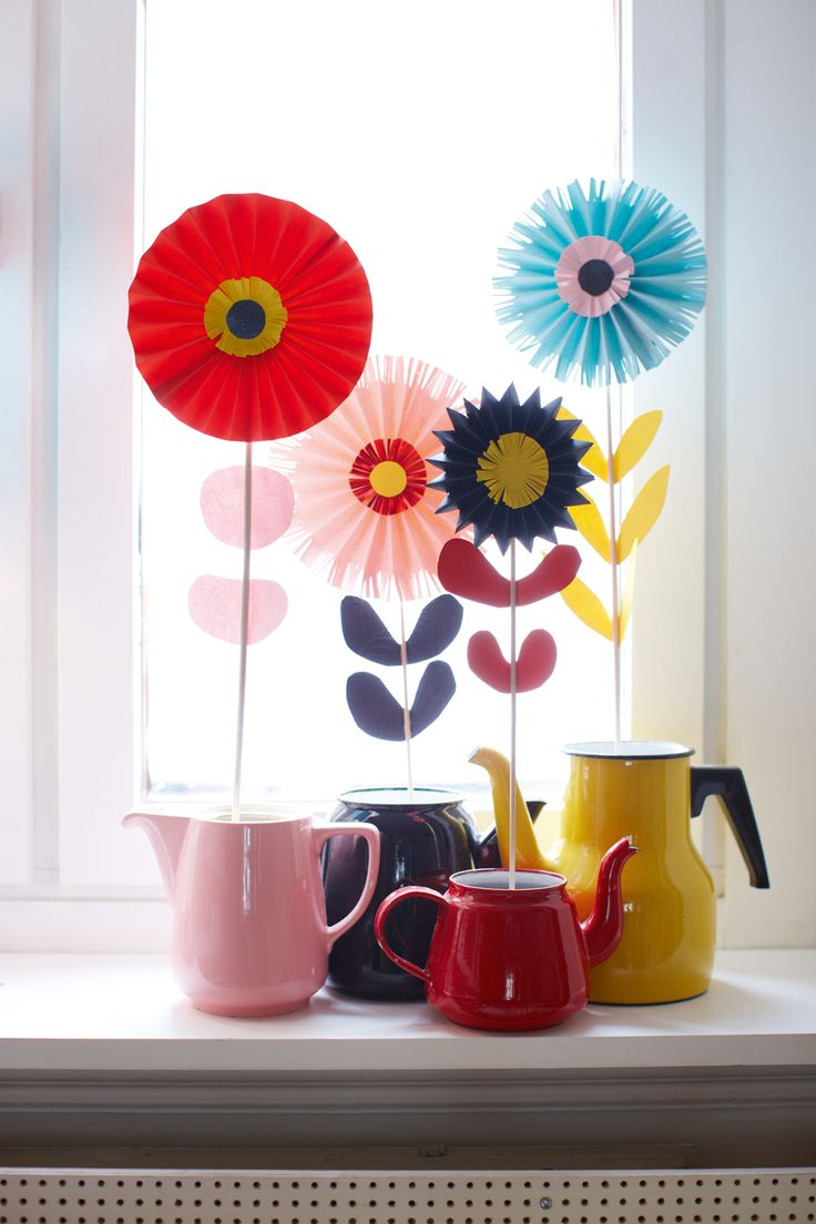 Camilla-Lundsten.  Cute.  My brain sort of likes that the leaves match the pitcher they're in.