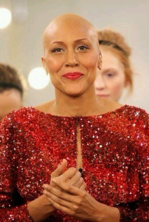 I look at this picture and see a beautiful, strong, thoughtful and passionate lady that had faith to keep pushing to win a battle that, not every women wins and its cancer..Beautiful Robin Roberts is a inspiration to women in our society today to overcome this long battle.