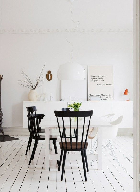 Scandinavian dining space in all black and white with modern furniture