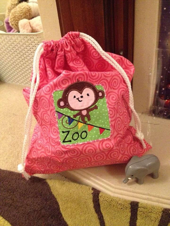 Embroidered drawstring bag with French seams. You storage for a zoo set.