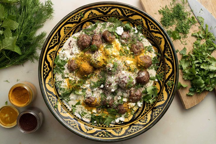 """These spice-loaded meatballs have a Turkish inflection The warm yogurt sauce adds tang and richness, along with a sprinkling of tart sumac powder and chopped mint American """"Greek-style"""" yogurt is not always tart enough, but it can be thinned with a bit of buttermilk or even lemon juice"""
