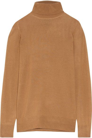 J.Crew works closely with a renowned Italian mill to create its soft, featherweight cashmere. Cut for a slightly loose fit, this camel turtleneck sweater is a versatile wardrobe staple will never date. Try yours layered under a denim jacket or button-down shirt.