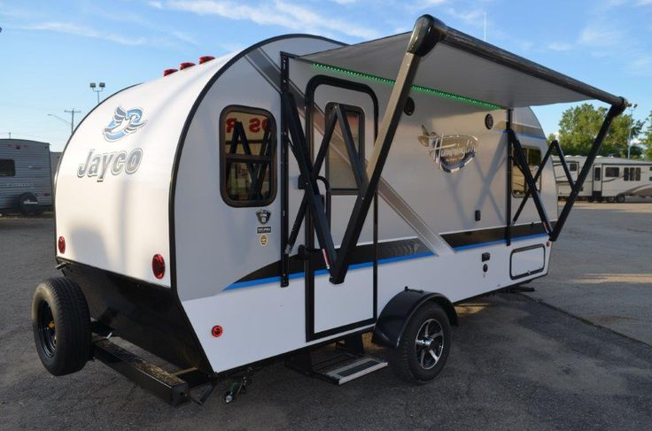 """GOOD THINGS COME IN SMALL TRAILERS!!!  2017 Jayco Hummingbird 17RK This compact 19' 9"""" long, 2910 lb. travel trailer is the perfect blend of functionality and portability. A 2' x 4' folding picnic table comes standard and it even includes its own interior storage compartment for easy stowing. Use it outdoors beneath your 10' power awning with LED lighting! Give our Hummingbird expert Brian Amato a call 810-965-2159 for pricing and more information."""