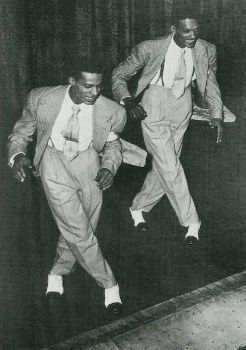 Coles & Atkins:  Cholly Atkins (left) was a tap and jazz dancer/choreographer best known for his contributions as the house choreographer and coach for Motown dancing vocal groups from 1965 to 1971.