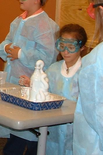 Elephant's Toothpaste   16 oz empty plastic soda bottle (preferably with a narrow neck such as those made by Coca-Cola)  1/2 cup 20-volume hydrogen peroxide (20-volume is 6% solution, purchased from a beauty supply store)  Squirt of Dawn dish detergent  3-4 drops of food coloring  1 teaspoon yeast dissolved in approximately 2 tablespoons very warm water