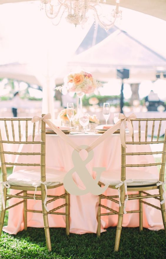 simple wedding sign ideas for bride and groom chairs