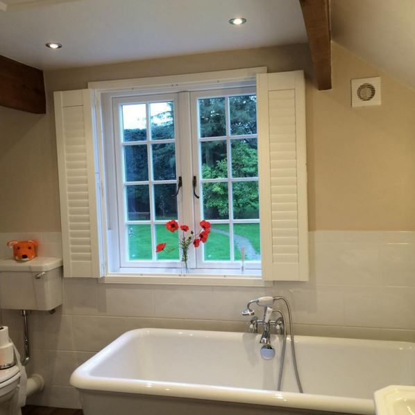 Wonderful inside shot of a happy customer's White Residence 9 windows and traditional hardware