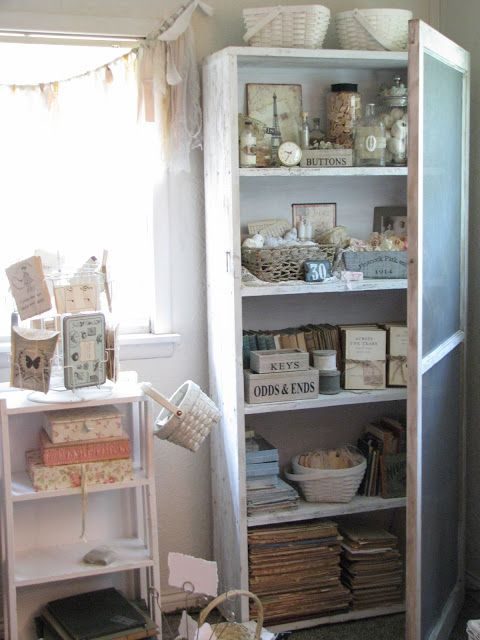 vintage screen door on bookcase--Love this idea to keep babies, kitties, and puppies away from my books!