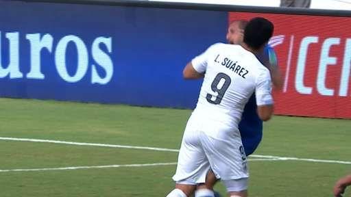 Luis Suarez appears to bite Chiellini
