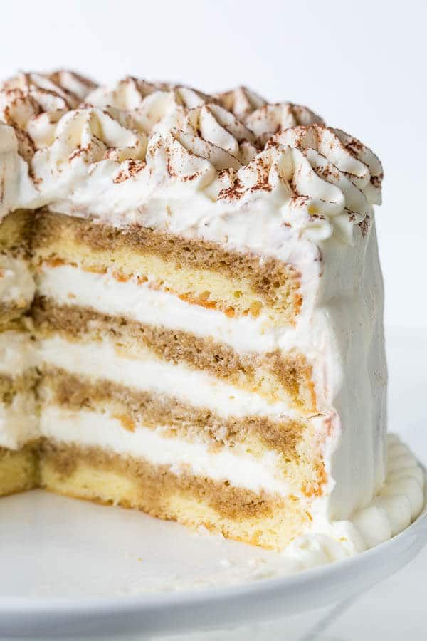 TIRAMISU LAYER CAKE. Melt in your mouth tender and light sponge cake layers are soaked with intense espresso and filled with fluffy eggless tiramisu cream. Dreamy dessert for all occasions!