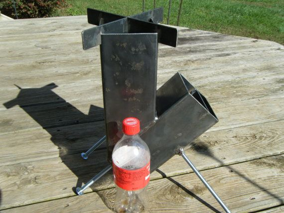 Brand new, self-feeding (gravity feed) rocket stove.  A great stove for camping, hunting, preppers, fishing, emergency and disaster preparedness. A handy item to have in the event of loss of electricity. Boil water and cook food for your family. Requires only small wood such as twigs, sticks, kindling, etc.  The self-feeding design makes tending the fire a bit easier as the fuel source keeps sliding into the fire chamber as it burns.  When disassembled, the stove will fit into a plastic 5…