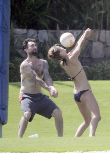 Adam Levine and his GF Nina Agdal caught playing volley ball in Los Cabos Mexico