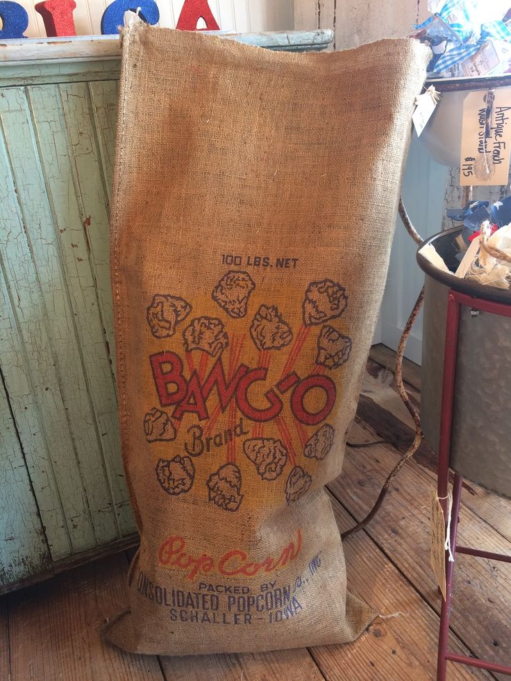Time for summer fun with a potato sack race! Vintage 1960's burlap popcorn sack (new old stock)  Ballard & Blakely Hours: Tuesday - Saturday 10:00 a.m. to 5:00 p.m. 5021 West Lovers Lane Dallas, Texas 75209Photo