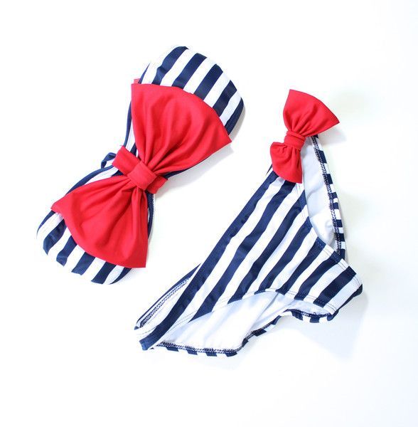 Two piece bandeau featuring a striped bow bra with removable soft cups. Includes detachable straps. Scrunch butt bottom. Fully lined. 80% nylon, 20% spandex. Measurements for references only Size S cl