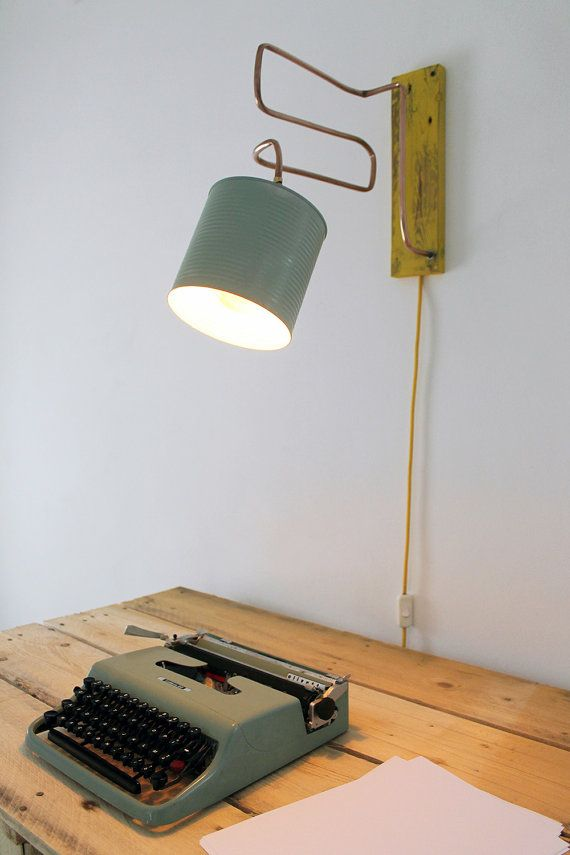 Lamp made with waste materials. The structure was obtained by recovering copper tube used for the water systems. Copper gives the lamp a simple design,