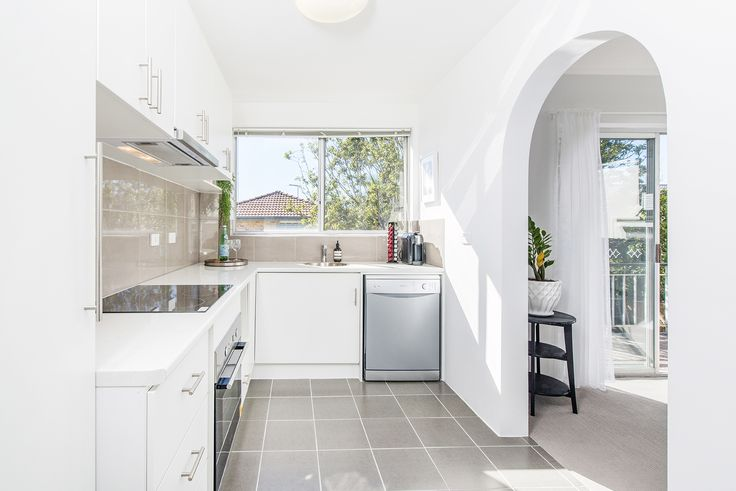 CHERMSIDE 3/17 View Street...Generous in size and providing plenty of privacy at the rear of the complex, the layout comprises a brand new kitchen serviced by crisp tiled flooring, premium stainless steel Bellini appliances, sleek soft-close cabinetry, and plenty of cupboard space.