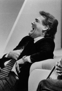 Chuck Woolery, American game show host laughing in stitches
