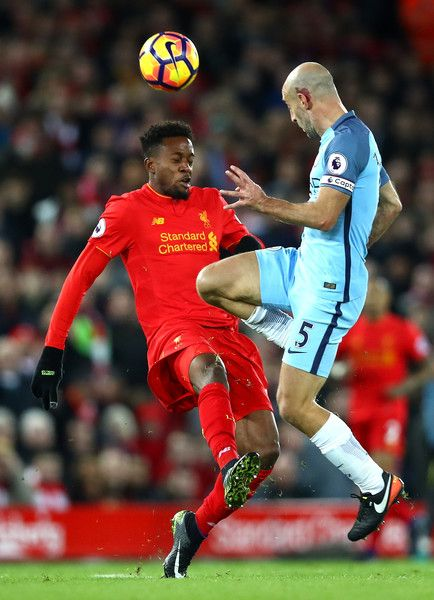 Pablo Zabaleta Photos Photos - Pablo Zabaleta of Manchester City and Divock Origi of Liverpool in action during the Premier League match between Liverpool and Manchester City at Anfield on December 31, 2016 in Liverpool, England. - Liverpool v Manchester City - Premier League