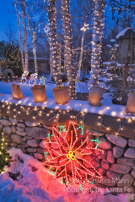 A yard filled with twinkling Christmas lights is part of the annual Christmas Eve celebration on Canyon Road in Santa Fe, New Mexico.