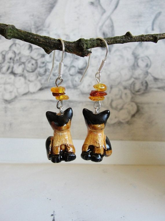 Siamese cats, Earrings, Dangle Jewelry, Gypsy,Nature Inspired, Silver 925 Earrings, Clay Ceramic, Porcelain, boho, Gift for her, splendid, unique  © ♠ Handmade with passion ♠ © Created in my home studio.  Lovely and absolutely unique: Siamese cats Earrings, dangle, silver Hooks Ag 925 with amber. Handmade clay ceramic porcelain.  Total length with hook about : 5 cm (1,9) height cats : 2 cm (0,7inches) ♥Jewelry with pure vibrations of nature. The beauty and harmony contained in flowers and…