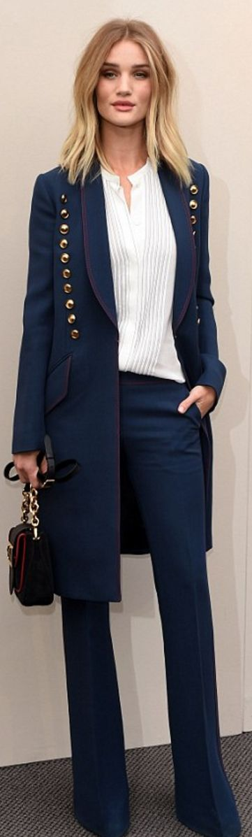 Who made  Rosie Huntington-Whiteley's white pleated top, blue pants, gold button coat, and handbag?