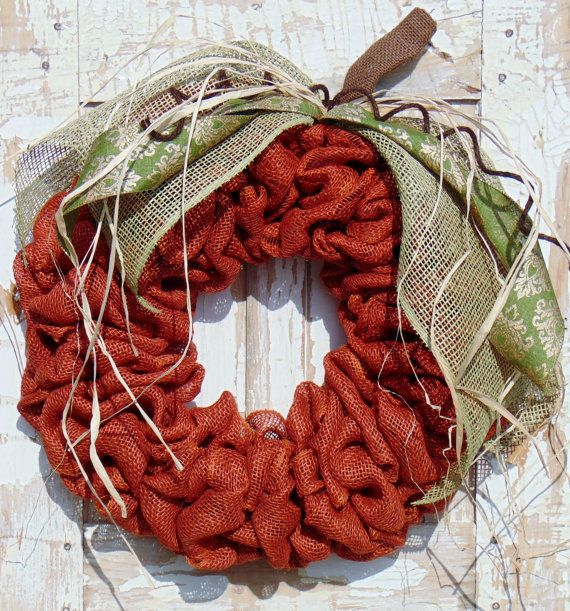 This full orange burlap wreath will give your front door the perfect fall touch. High quality burlap and ribbons really make this pumpkin