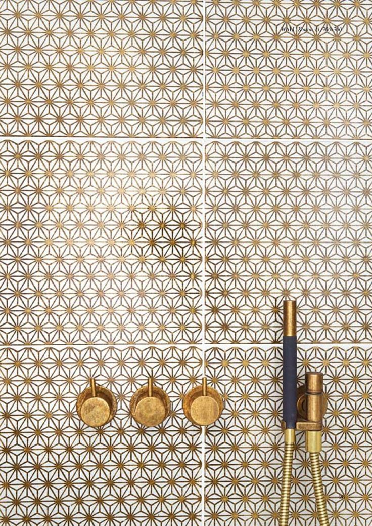 As a kitchen splashback in a grey kitchen with brass pendants. Made A Mano Collection// Gold pattern bathroom tiles//