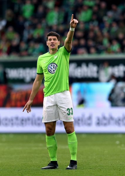 Mario Gomez of Wolfsburg gestures during the Bundesliga match between VfL Wolfsburg and SV Darmstadt 98 at Volkswagen Arena on March 18, 2017 in Wolfsburg, Germany.