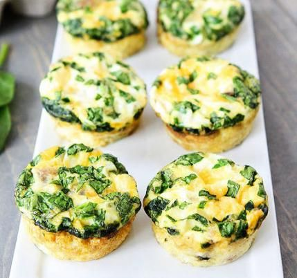 Egg muffins with sausage, spinach, and cheese are a delicious low-cholesterol recipe.
