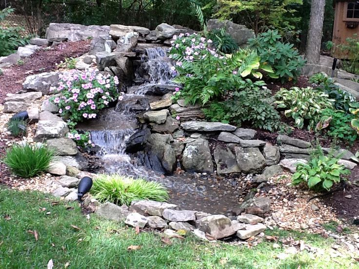 Jvi secret gardens installed this 16 39 long low maintenance for Backyard pond maintenance