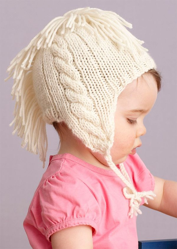 Free knitting pattern for Cabled And Fringed Hat - Design ...