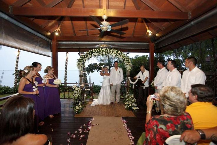 White roses create a stunning flower arch for this Sala ceremony set-up