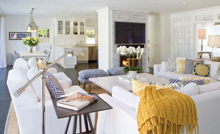 Love this white room with blue & white and pops of yellow. Across the room is blue sign as art.